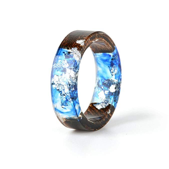 nillo único hecho a mano de resina de madera con lámina de plata en el interior del océano y cristal azul